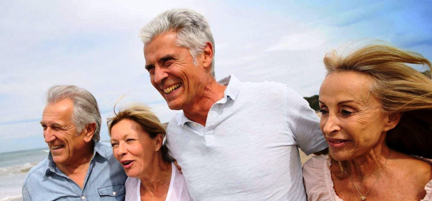 45367326 – senior people walking on the beach